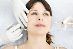 1493387-young-caucasian-woman-receiving-an-injection-of-botox-from-a-doctor